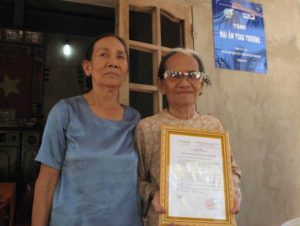 An extreme poor old lady received a friendship house built from MCNV microfinance projects in Ben Tre 2015